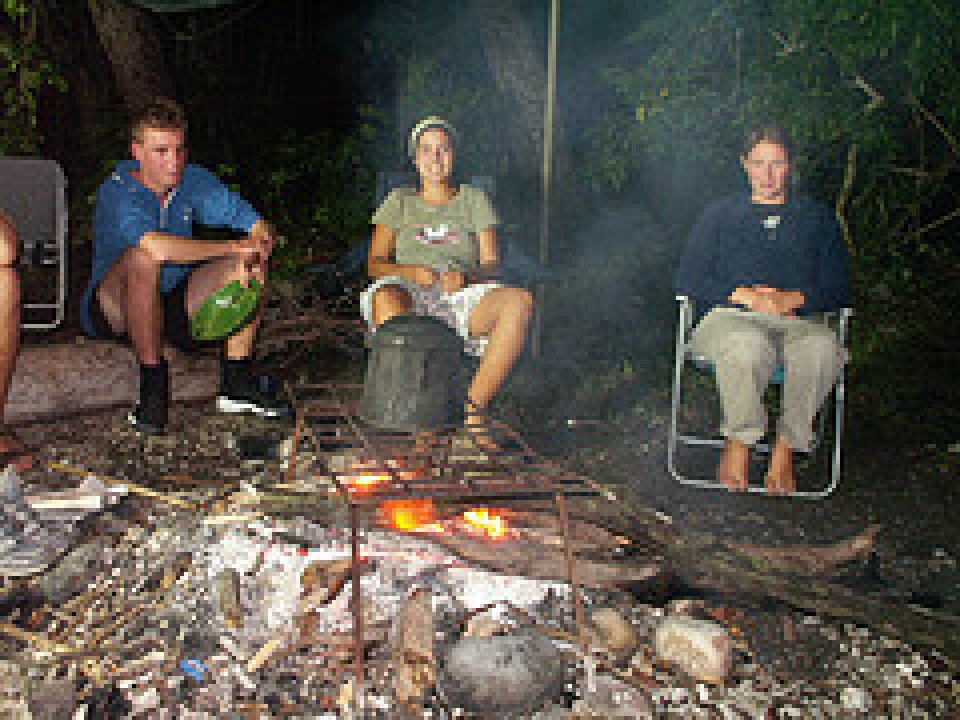 Pelorus Island - Eating dinner by the light of the campfire.